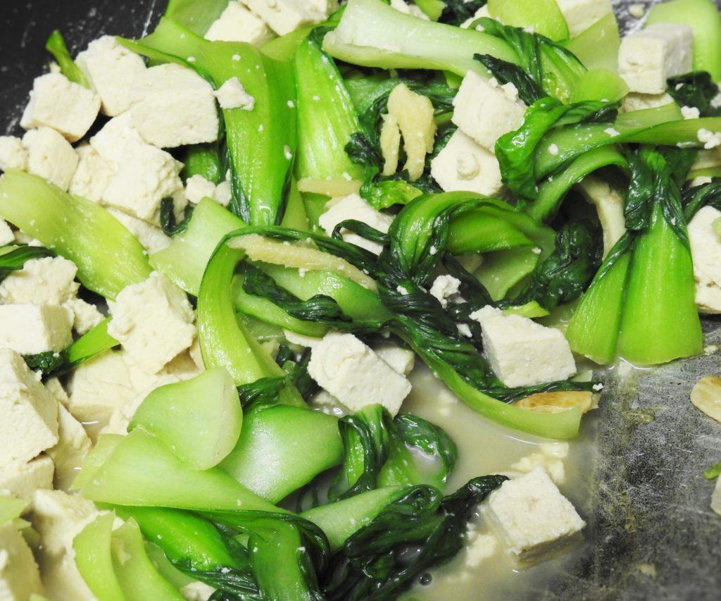 Stir-fry Bok Choy in a wok