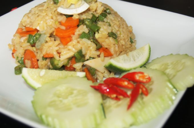 Salted Eggs Fried Rice Served with Cucumber, Thai Chili, and Limes