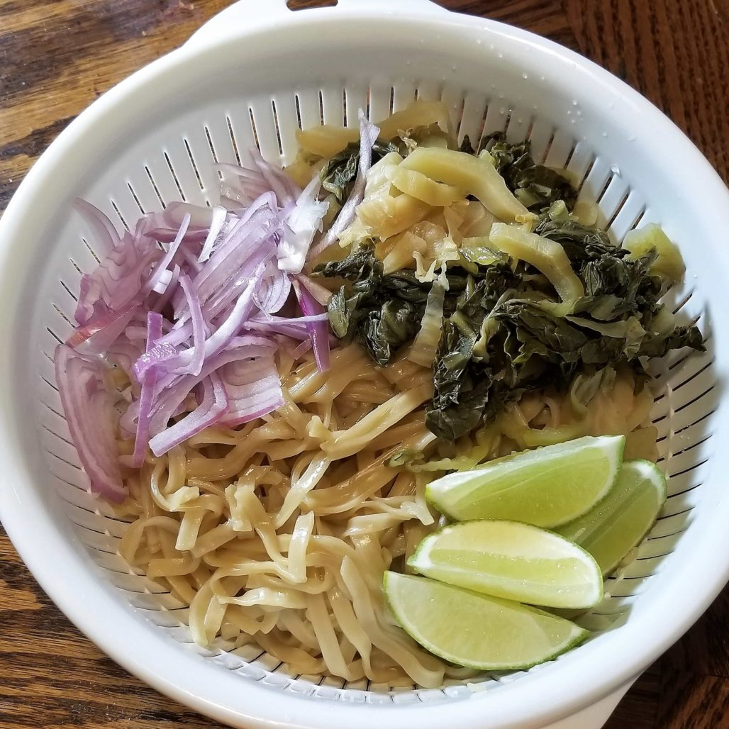 Khao Soi Toppings Noodles, Mustard Onions and Lime