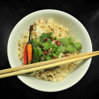 Tom Ka Gai Rice Garnished with Cilantro and Thai Peppers