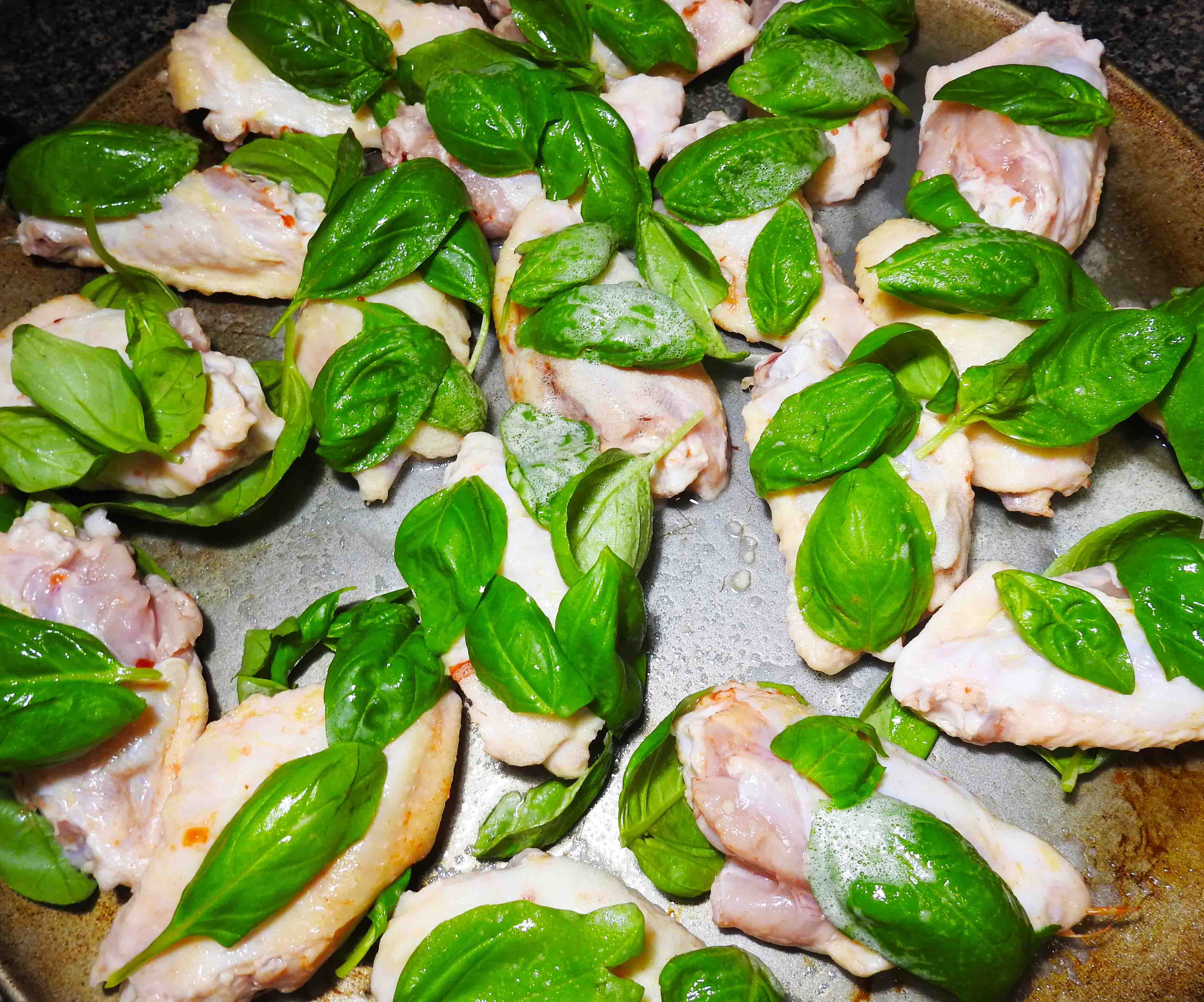 Adding Basil to Chicken Wings for Thai Basil Chicken Wings