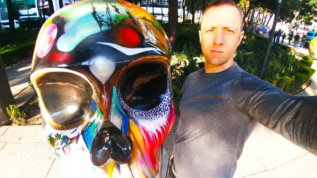 Me with one of the many skulls downtown Mexico City With Mexico Running Tours