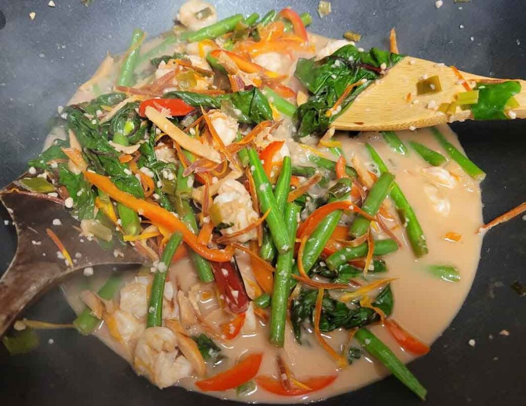 Stir-fried organic veggies and shrimp in wok