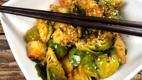 Garlic Butter and Red Curry Brussels Sprouts and Crab Flambée